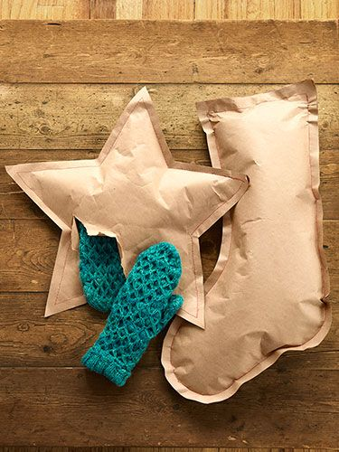 Shaped gift packets - Layer two pieces of kraft paper together and drawing your chosen shape (star, stocking, or other Yuletide symbol) on the top piece. Cut through both layers of paper, then sandwich a gift between the two shapes and stitch along the edges using contrasting thread.