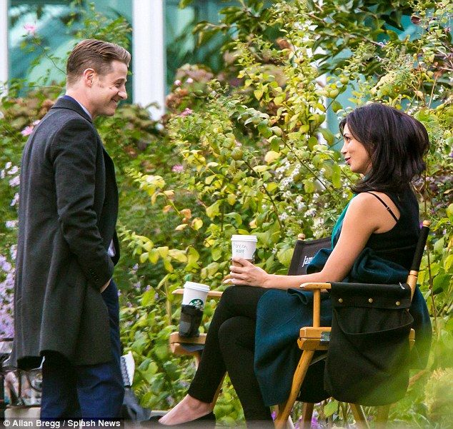 Flirty glances: Benjamin McKenzie gazed adoringly at his pregnant leading lady on and off-screen, Morena Baccarin, on the Brooklyn set of Gotham on Friday