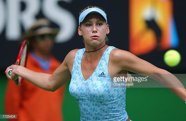 Anna Kournikova of Russia in action against Justine HeninHardenne of Belgium during the Australian Open Tennis Championships at Melbourne Park in...