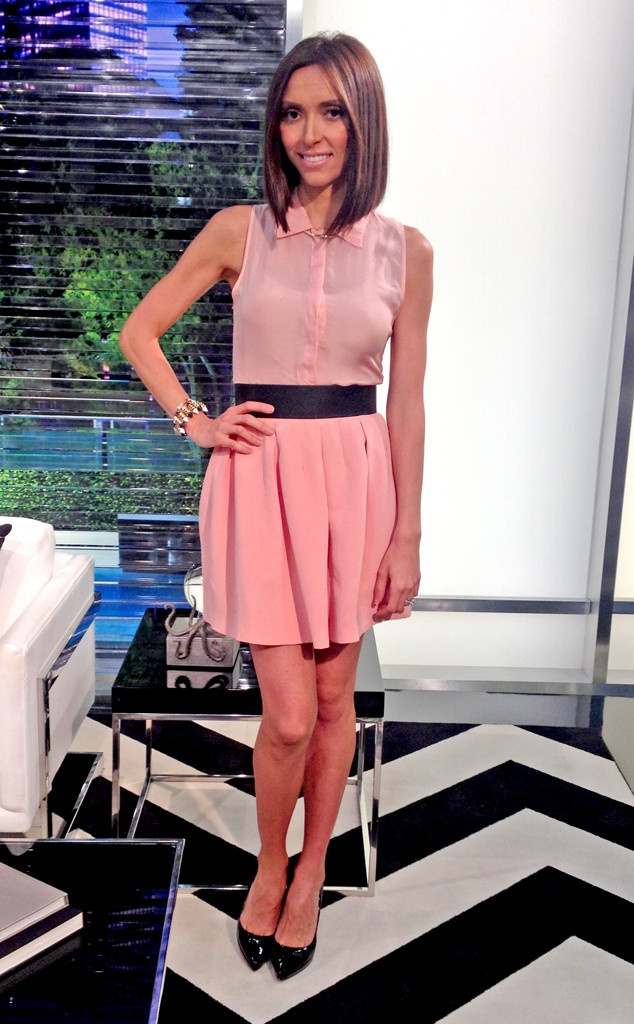 Giuliana Rancic looks adorable in a soft pink sleeveless shirt and matching A-line skirt by Rebecca Vallance.