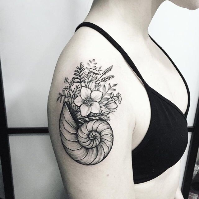 shell and florals tattoo