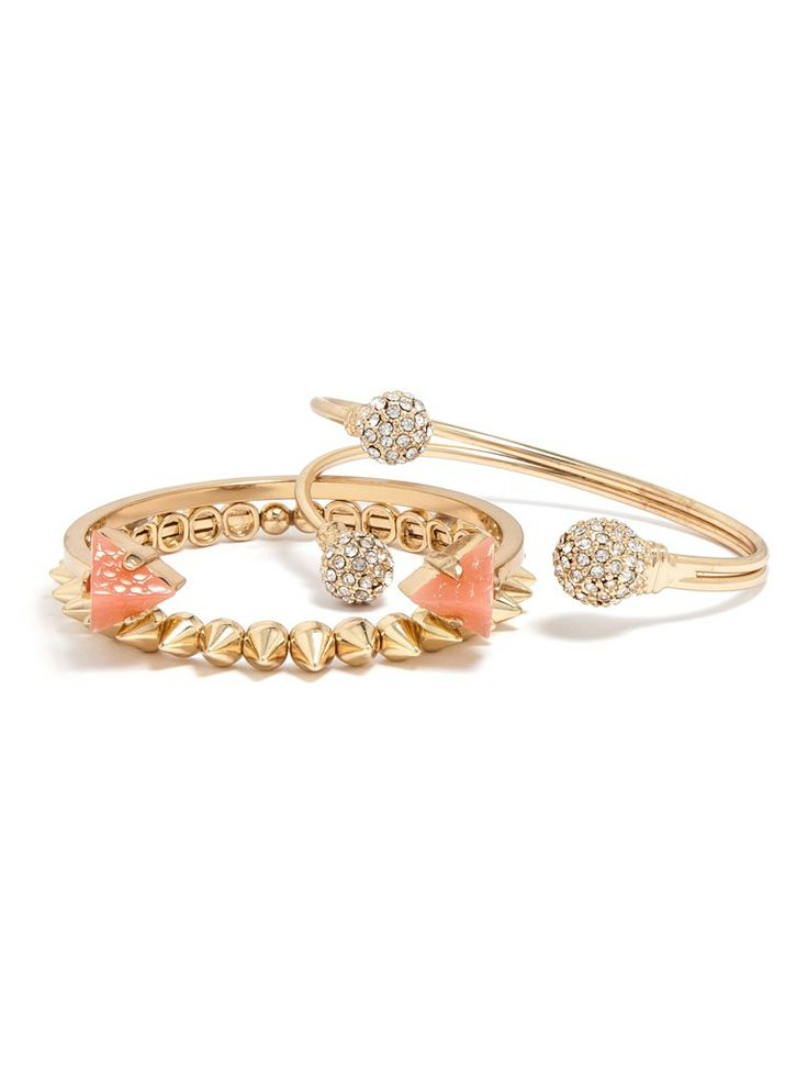 Spikes, spheres, and triads accented with hot pink gems and pave stones create a fun, flossy arm stack.