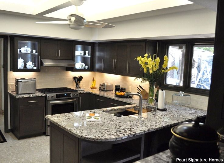 Basic Bathroom Remodel With An Open Skylight, Granite Counters, White  Backsplash And Stained,