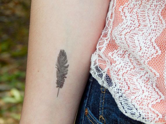 … this funny little feather… | 17 Fake Tattoos So Good You'll Wish They Were Actually Real