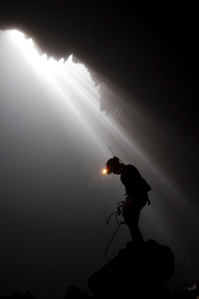 """""""A student from the University of Indonesia stands inside Jomblang cave at Gunungkidul district, near the ancient city of Yogyakarta June 20, 2012."""" (Photo by REUTERS/Dwi Oblo)"""
