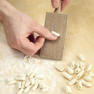 How to make Malloreddus, tiny Sardinian Dumplings usually served with butter and Pecorino or a Simple Tomato Sauce.