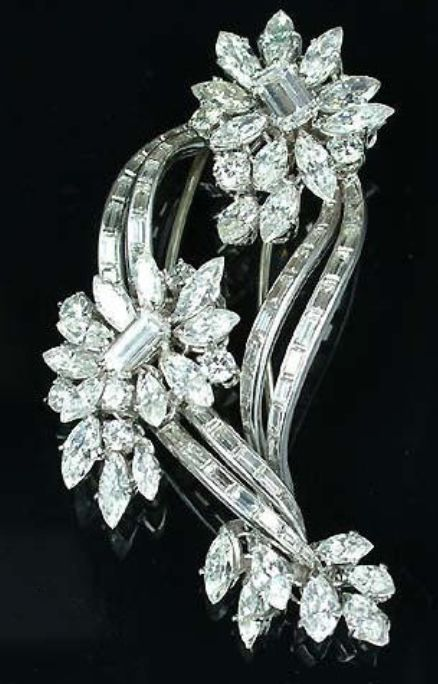 A diamond brooch, circa 1960, the two stylised flowerheads each set at the centre with a step-cut diamond within a petalled border of marquise and brilliant-cut diamonds, connected by baguette-cut diamond stems, unsigned, Kutchinsky case, diamonds approximately 10.00 carats total