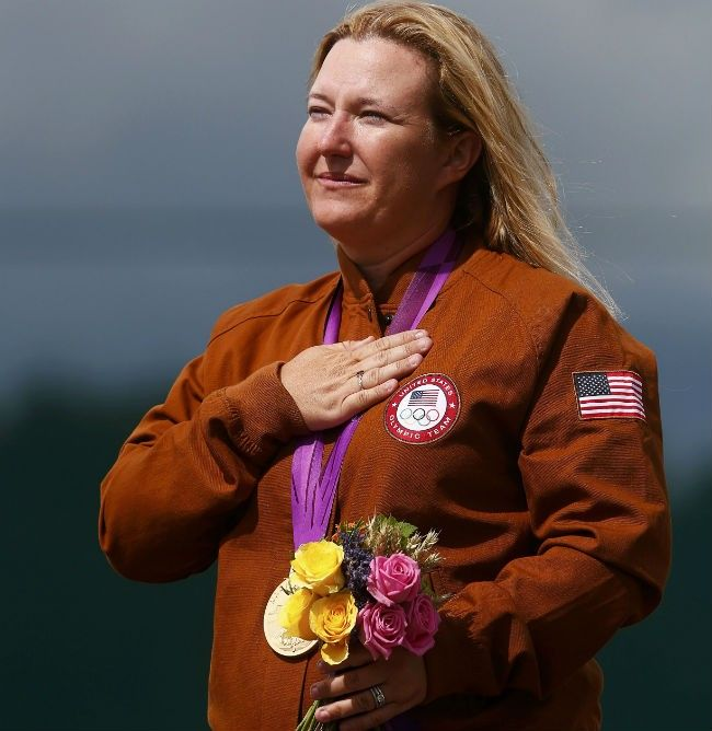 Congrats! USA's Kimberly Rhode shoots near perfect round (99 out of 100) for GOLD in skeet.