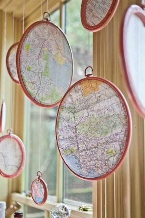 Map pendants for world/travel themed room. DIY in embroidery hoops.