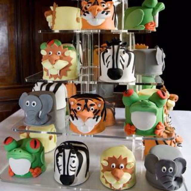Cute!!! http://www.google.com/search?tbm=isch&source=mog&hl=en&gl=us&client=safari&tab=wi&q=birthday%20zoo%20cakes&sa=N&biw=320&bih=356#i=20