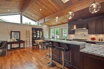 Kitchen With Wood Paneled Vaulted Ceiling And Skylight