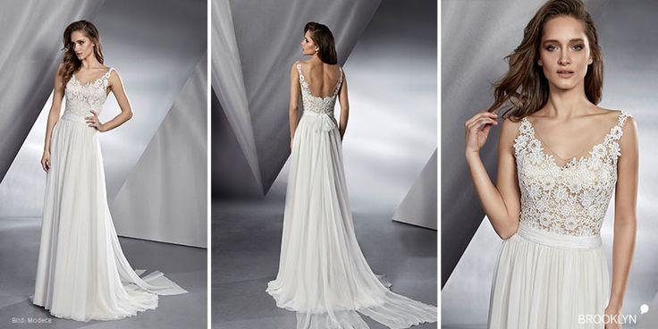 Romantisches Brautkleid mit Trägern aus Spitze mit fließendem Rock und langer Schleppe. Die Le Papillon-Kollektion von modeca 2018 ist erhältlich im brautgeflüster in Villach.