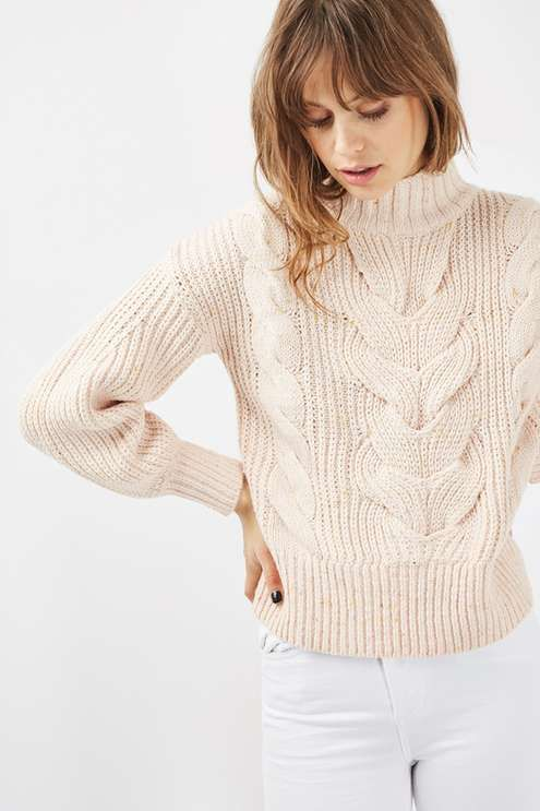 A winter classic, you can't go wrong with a cable knit when dressing for the cold. This oversized nep jumper comes with a high neck and is finished in a neutral nude hue. #Topshop