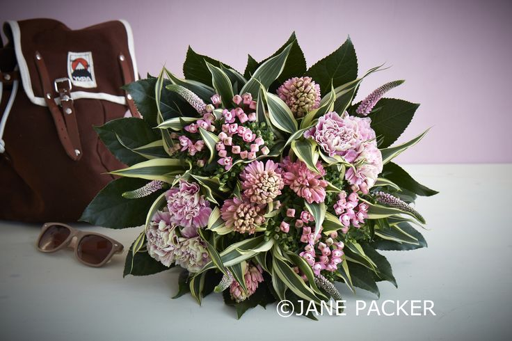 An adorable hand-tied bouquet containing a delightful mix of spring flowers/ Baby pink Bouvardia, feathery Veronica, pastel pink Hyacinths, vintage toned Carnations and an abundance of greenery.