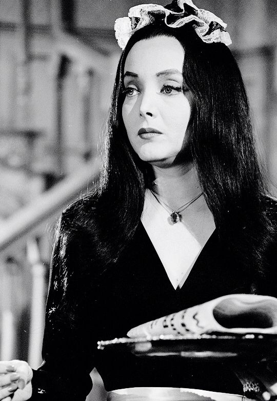 Morticia Addams pretends to be Lurch's maid in The Addams Family: Mother Lurch Visits the Addams Family (1965)