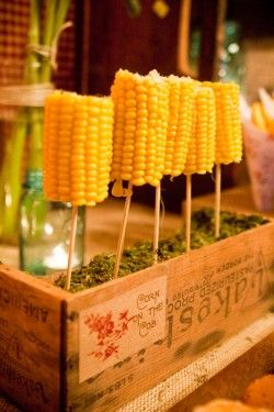 Love the idea of putting corn on the cob on a stick for a 4th of July party festa junina, milho, milho verde, milho festa junina
