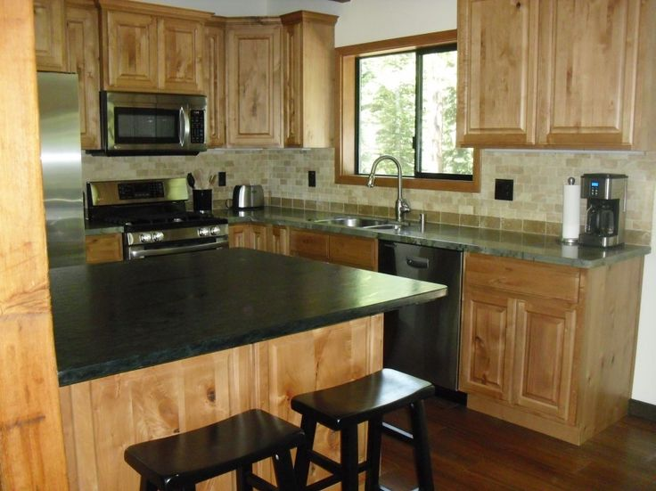 Furniture Kitchen. Enchanting Soapstone Countertops For Kitchen Table Decoration Ideas: Natural Looks Oak Unfinished Kitchen Cabinetry Set With Black Soapstone Countertops Also Double Black High Counter Stools In Traditional Kitchen Ideas
