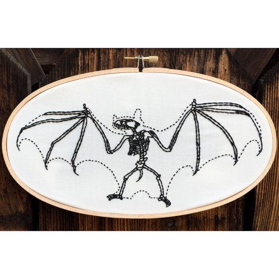 Hand embroidered bat skeleton in oval hoop, macabre halloween embroidery, animal anatomy art