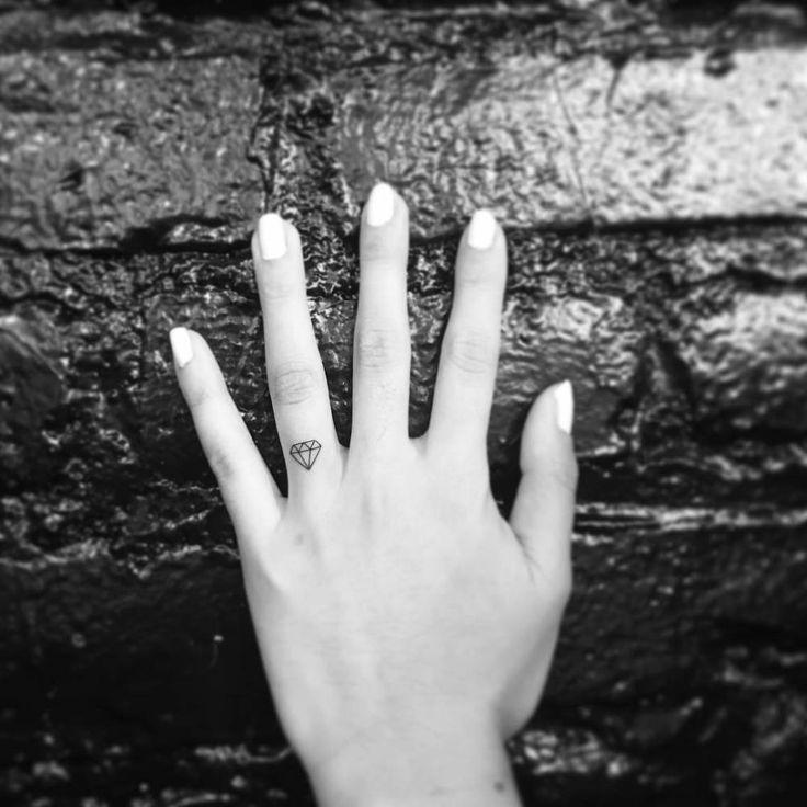 Small diamond tattoo on the left ring finger. Tattoo artist: OK