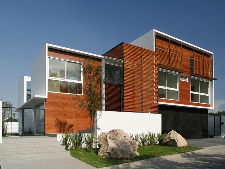 Пример отделки сайдингового загородного дома оранжевого цвета в современном стиле