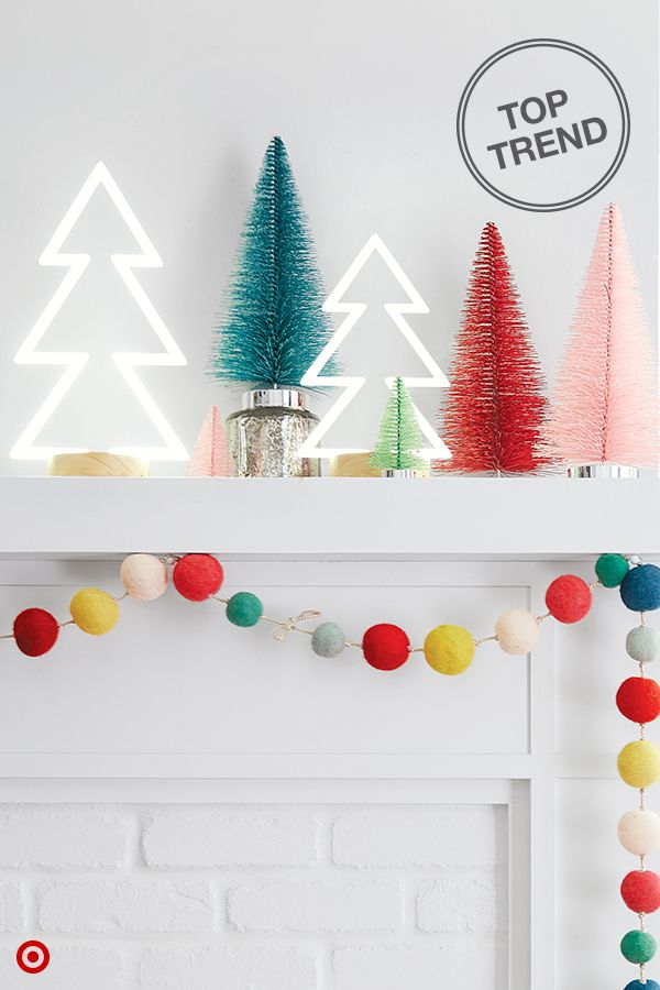 Who says you need to decorate for Christmas in classic reds and greens? Break tradition and decorate your mantle in bright, bold colors and unexpected decor pieces. Mix colors combos, textures and finishes to create a look thatÍs uniquely you. Playful pom pom garland, metallic bottle brush trees and fun neon light trees help bring on modern merriment. Go all out!