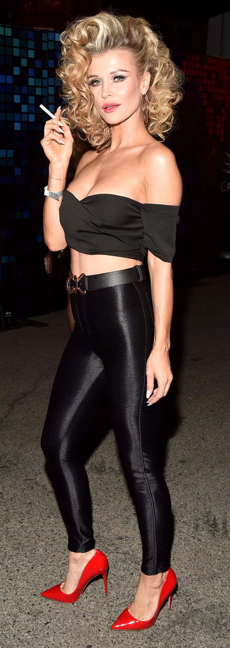 Joanna Krupa rocked it as Sandy from Grease in an amazing Halloween costume at George Clooney's annual Casamigos 70's inspired party. Wearing the iconic black leather outfit, which Olivia Newton-John at the end of the 1978 film, Krupa really nailed it with her curly blonde hair and red shoes #JoannaKrupa #Grease #Halloween