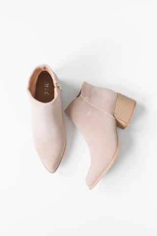 "- Light beige ankle booties with a faux suede texture - 2"" cut-out back heel - Inside zipper for easy on and off closure - Slightly pointed toe - Lightly padded insole - Rubber sole - True to US size"
