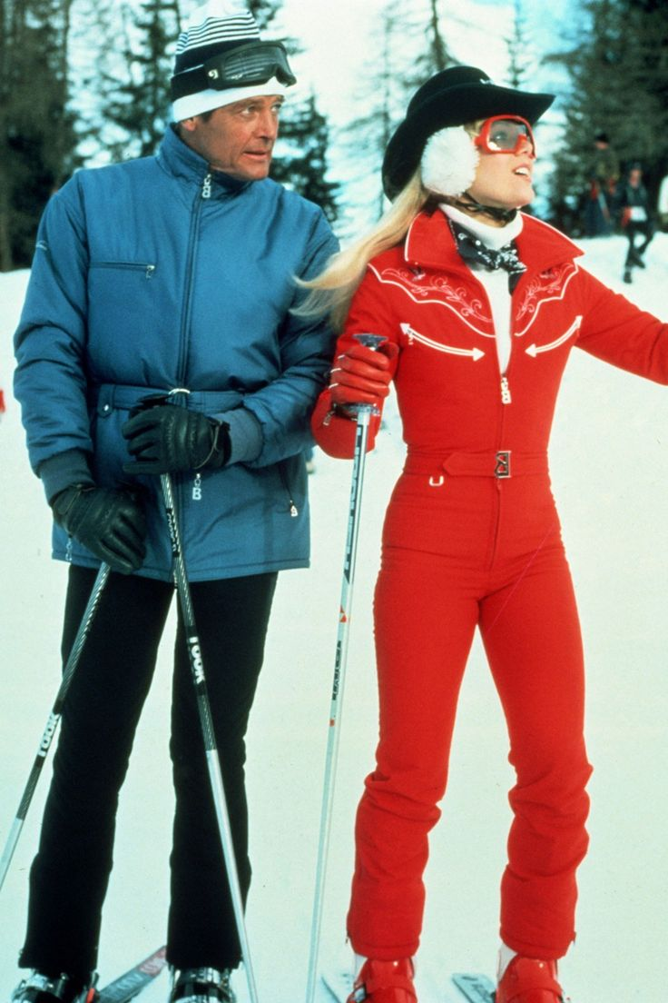 Roger Moore and Lynne-Holly Johnson skiing