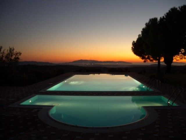 Sunset above the swimming pool at Fattoria La Capitana, Magliano in Toscana, Tuscany. http://www.canadianisland.it/c/gallery