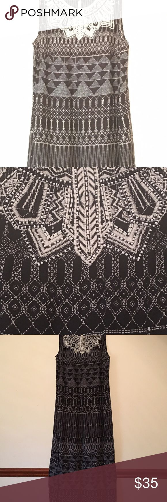 Gorgeous Aztec printed dress Aztec printed dress with two side slits and also a deep keyhole closure it back Dresses Maxi
