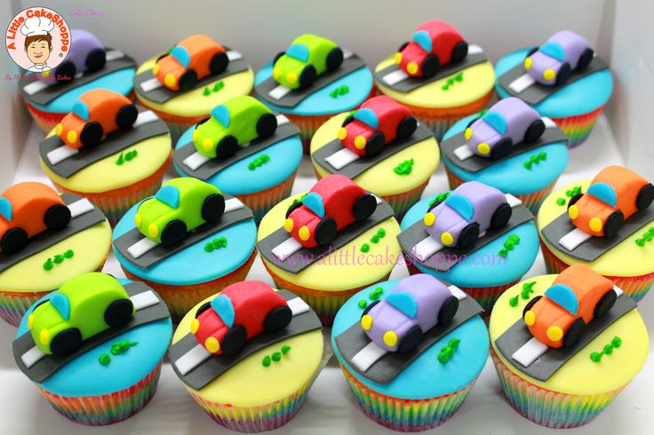Rainbow cupcakes with handmade sugar car toppers  Code: CB014  For enquiries, please email to info@alittlecakeshoppe.com  www.alittlecakeshoppe.com Instagram - instagram.com/alittlecakeshoppe Pinterest - pinterest.com/ALCSingapore  #Cars #CustomCupcakes #CustomCakes #ALittleCakeShoppe #Singapore #Customised #Birthday #Cakes #Cupcakes