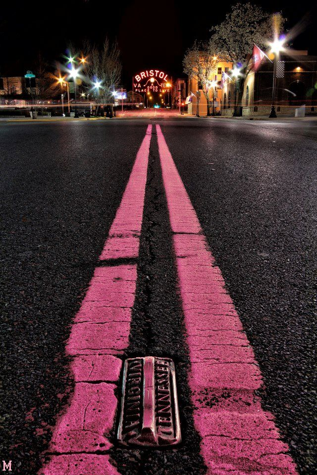 Bristol on the state line between Tennessee and Virginia.The sign and the street all decked out in pink for breast cancer awareness in October.