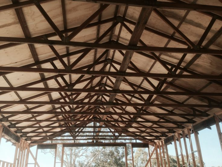 Using salvaged roof trusses from a house we demolished, making of a barn.