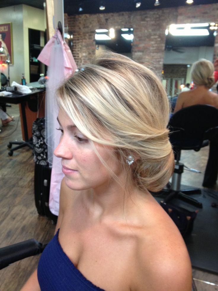Beautiful bridal chignon. Wedding hair, bride, side Updo