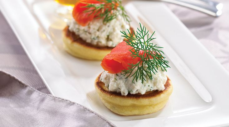 A sophisticated crowd pleaser, Tre Stelle Blinis  with Smoked Salmon, Ricotta and Capers won't  disappoint! #ALoveAffairWithCheese #Capers
