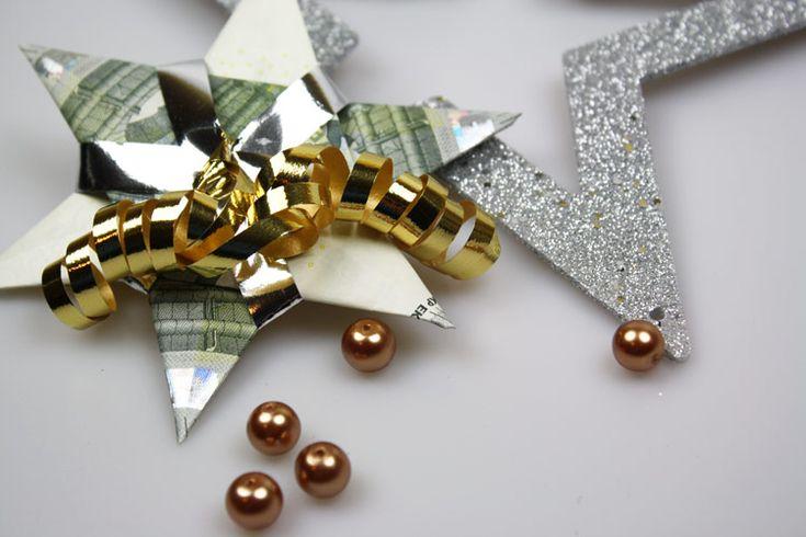 Originelles Geldgeschenk zu Weihnachten: Falte einen Stern aus Geldscheinen. Hier geht's zur Schritt-für-Schritt-Anleitung - jetzt basteln!