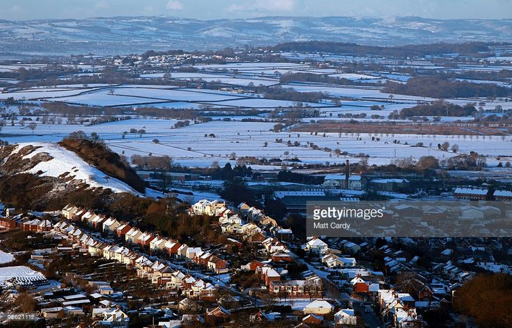 Snow is seen in fields and across rooftops viewed from Glastonbury Tor on January 7, 2010 in Somerset, England. Extreme weather warnings have been issued across England as heavy snowfall and freezing temperatures have continued to cause disruption on roads and led to the closure of hundreds of schools and airports. According to the Met Office the latest Arctic cold snap forecast has made this Britain�s coldest winter for 30 years.