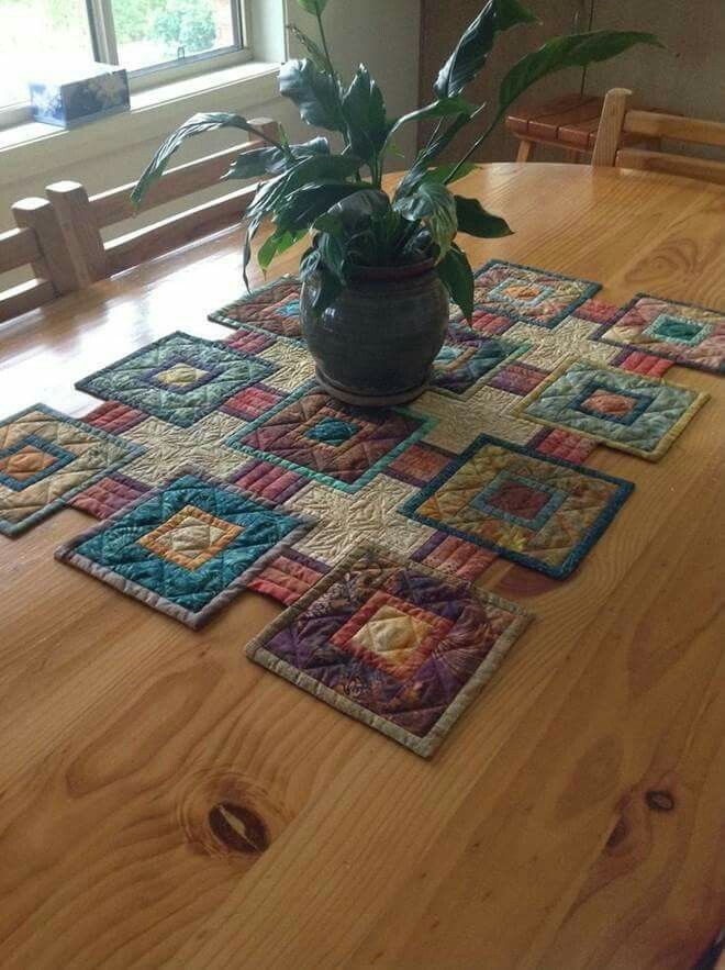 The pattern is called Stepping Stones by Mabeth Oxenrider and it is in American Patchwork & Quilting Oct 2009. There is a smaller version of it on All People Quilt done in Christmas colors and it is free. Still trying to find the link to purchase the pattern.