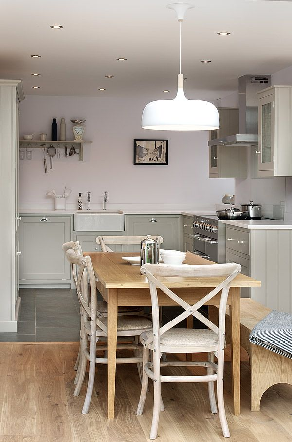 The Silverdale Shaker Kitchen by deVOL - The fitted Shaker kitchen in this traditional detached cottage has a clean crisp finish that feels light and inviting. A soft colour palette helps to blend the kitchen into the living space, with a 'U' shaped layout and our tall 'Larder Combination' cupboard to make the most of the space available.