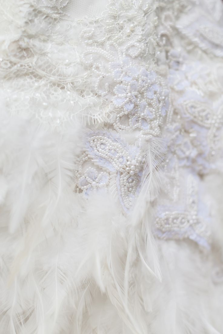 Lace & feathers make a good combination in a wedding dress. Dress by Mytsah