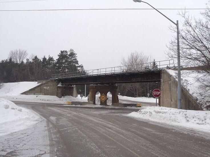 The Vandorf Sideroad CNR Bridge is a railway bridge in the community of Vandorf, Ontario, Canada.The bridge forms part of the Canadian National Railway line in the area and crosses Woodbine Avenue at Vandorf Sideroad. The concrete bridge abutments were built in 1950, and the builder's plate on the bridge confirms the steel deck was constructed in 1952 by the Central Bridge Company in Trenton, Ontario.