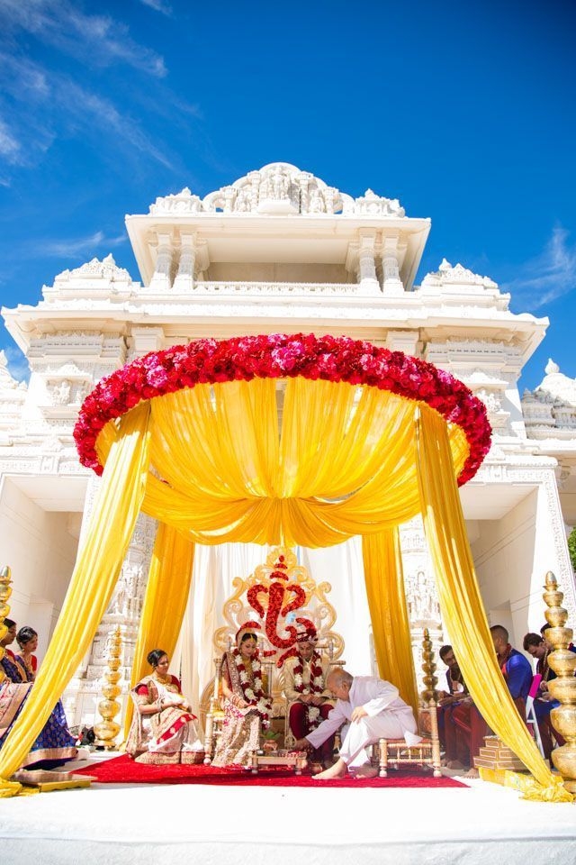 Bright yellow mandap | The BAPS Shri Swaminarayan Mandir Complex in Bartlett, IL | Photography: Rahul Rana | See the full wedding: http://www.xaazablog.com/colorful-indian-wedding-and-wedding-deal/