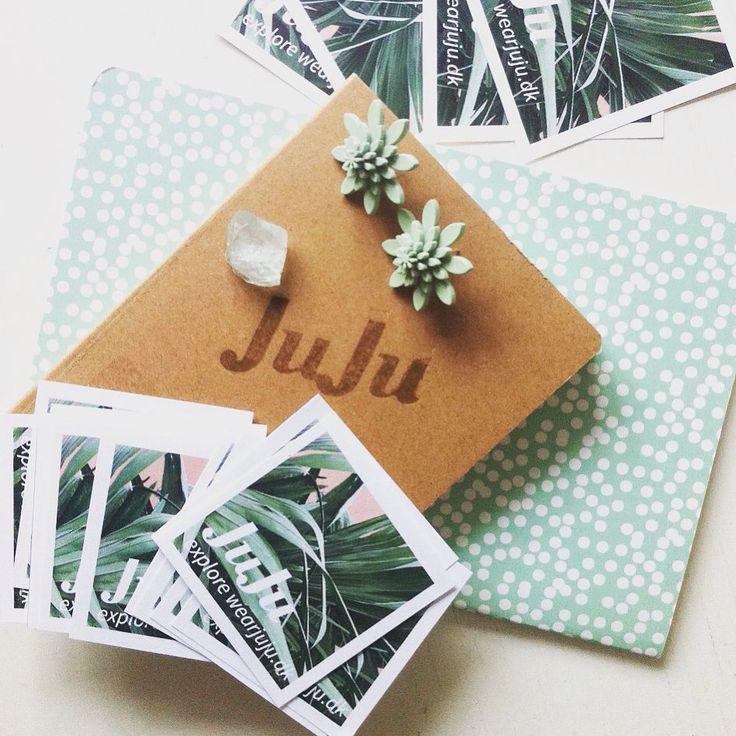 #Beautyful JuJu mess on a #JuJu desk. #Ideabook #branding the #oldschool way. Fresh #mint #plexiglass #earrings & #chrystal. #botanical #collage #JuJu #flowers #copenhagen #copenhagendesign