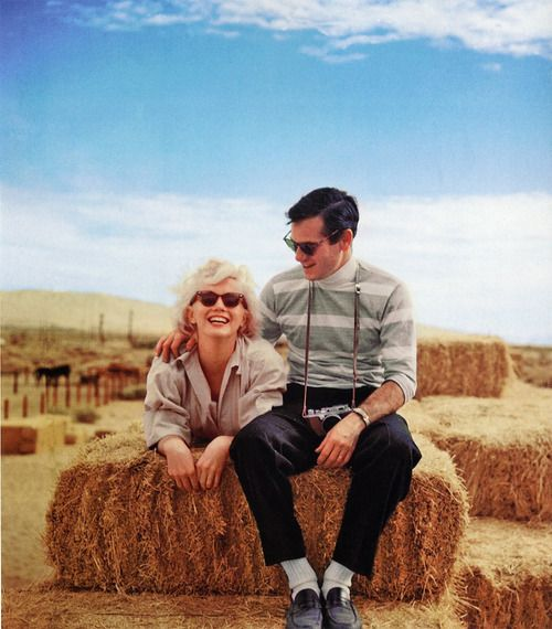 Marilyn Monroe and Milton Greene... taking a break from his camera. I always loved how open and whole-hearted her smile is
