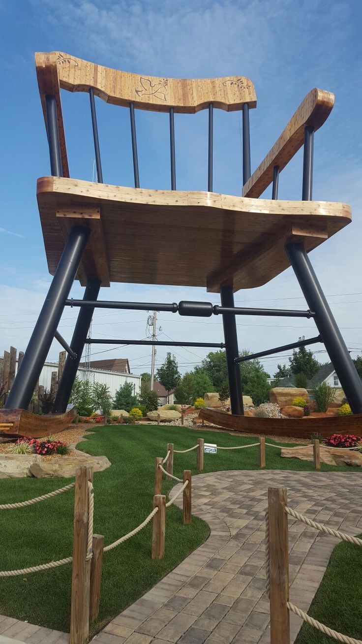Set of armchairs and rocking chairs just out from beneath the shelter - Casey Illinois Worlds Largest Rocking Chair