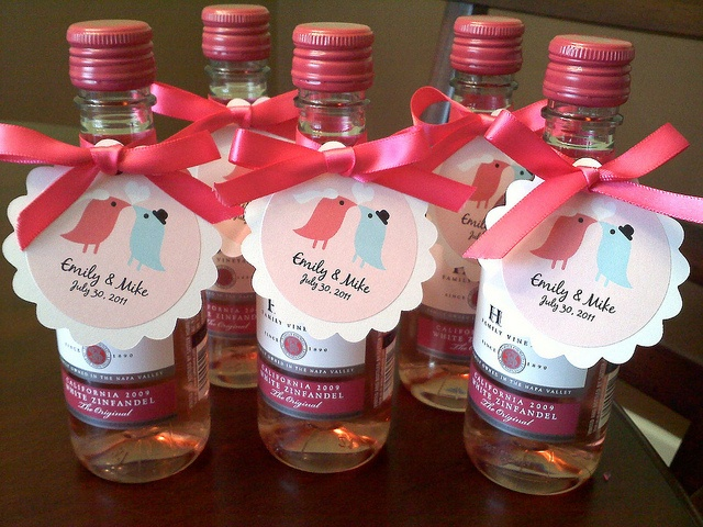Mini wine bottle favors with personalized tags