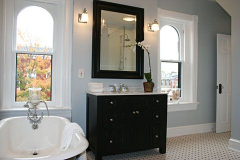 Love this paint color (and bathroom).  Light French Grey by Behr.