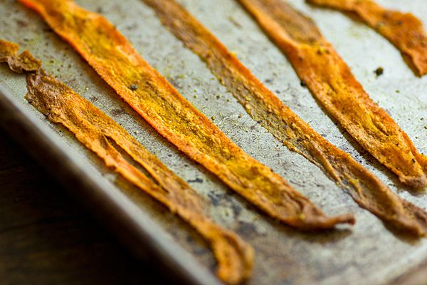 This Curried Baked Carrot Chips recipe makes an easy, healthy snack. Use a vegetable peeler to slice carrots into strips then bake them until they're crispy