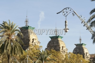 scenic towers rooftops of historical Palau de Justícia building in Barcelona, Spain
