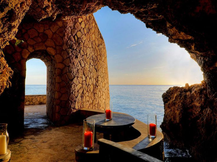 The Caves Caribbean Dining Drink Eat Luxury Romance Romantic Scenic views Tropical Waterfront water outdoor building mountain arch Sea evening overlooking formation